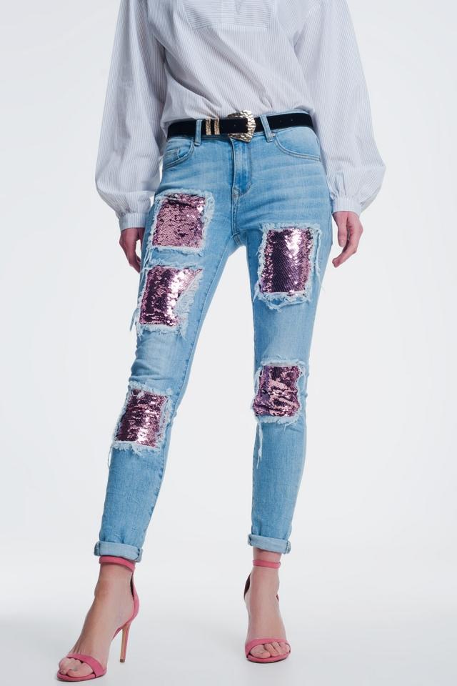 jeans met scheuren en roze en gouden lovertjes