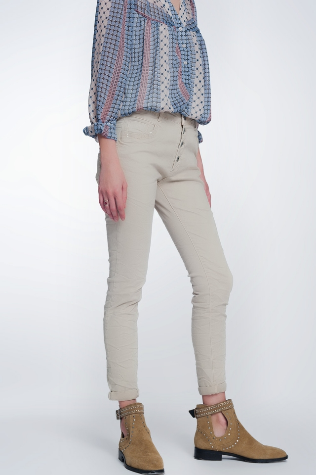 Beige boyfriend broek met pailletten zak detail