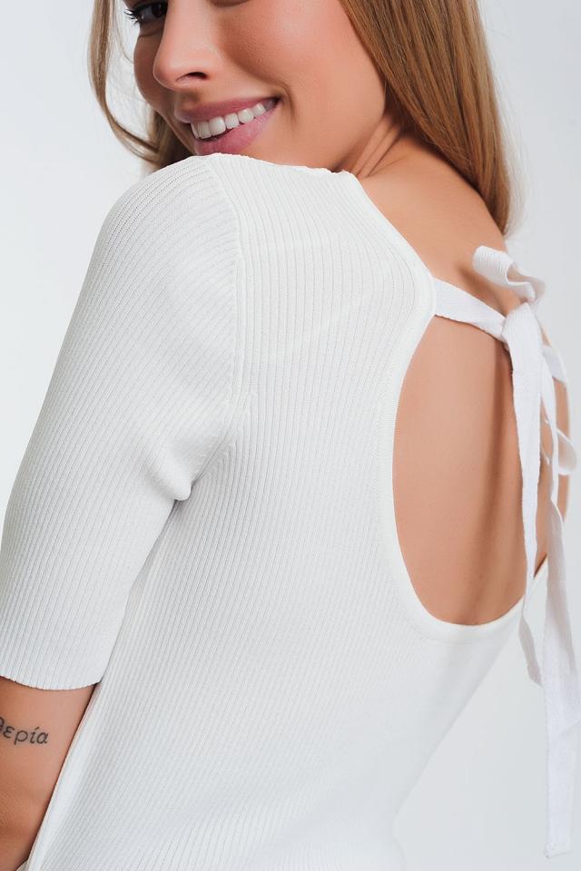 Gebreide trui met strik aan de achterkant in cream