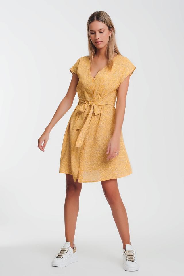 Aangerimpelde jurk met mustard knoopsluiting en fijne print