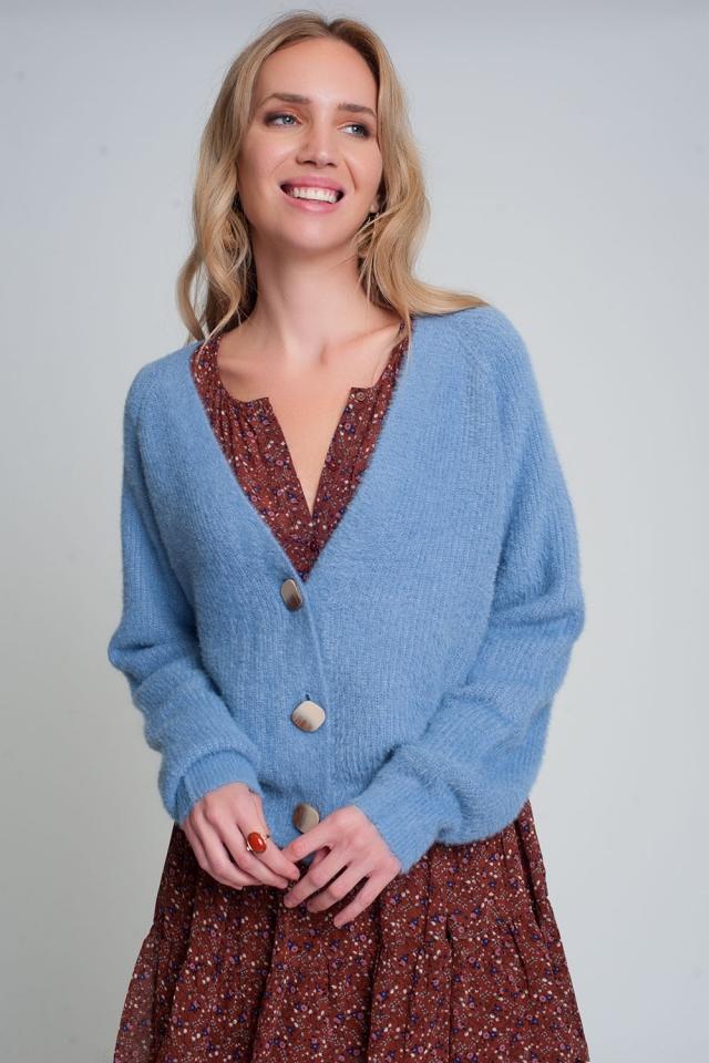 Zacht vest met knoopjes en diepe v-hals in blau