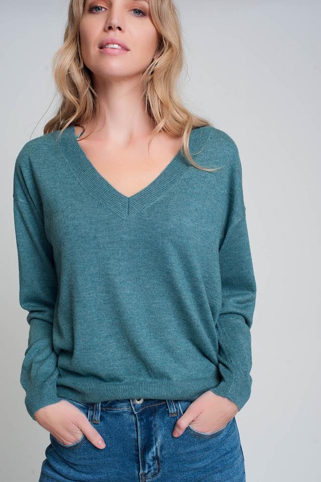 Fijn gebreide groene trui met v-hals