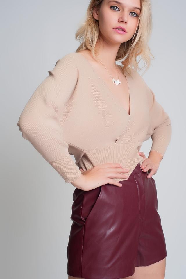 Gebreide trui met omgeslagen V-hals in beige