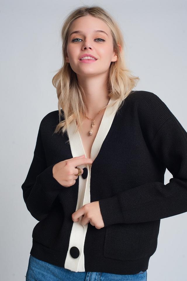 Gebreid vest met witte details in zwart