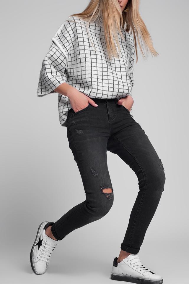 Superskinny jeans met scheuren in zwart met wassing