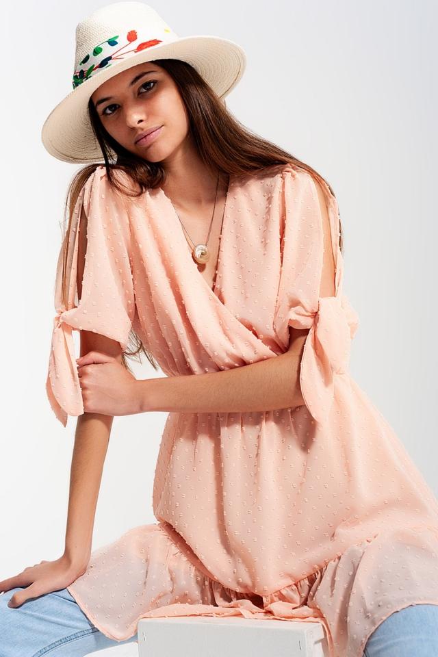 Mini-jurkje met bindceintuur in Roze