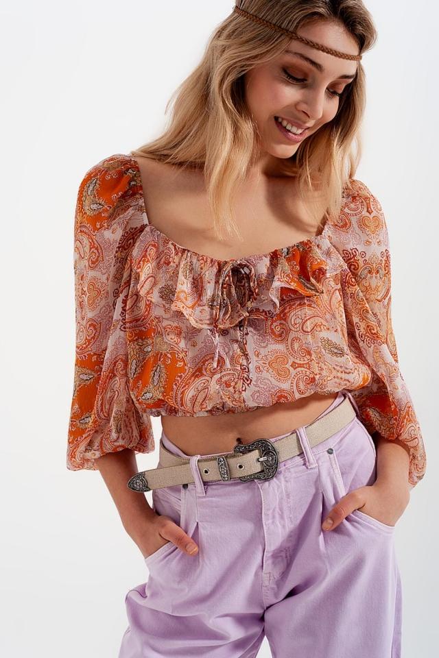 Doorschijnende top met lange mouwen aangerimpelde taille en strikdetail in oranje print