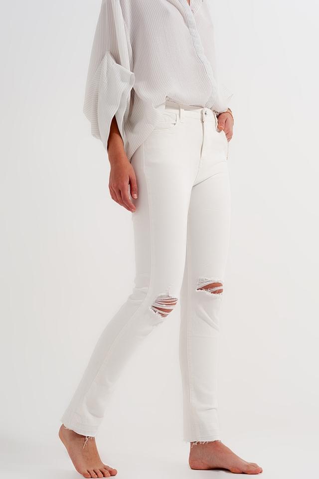 Jeans met scheuren en gerafelde zoom in créme