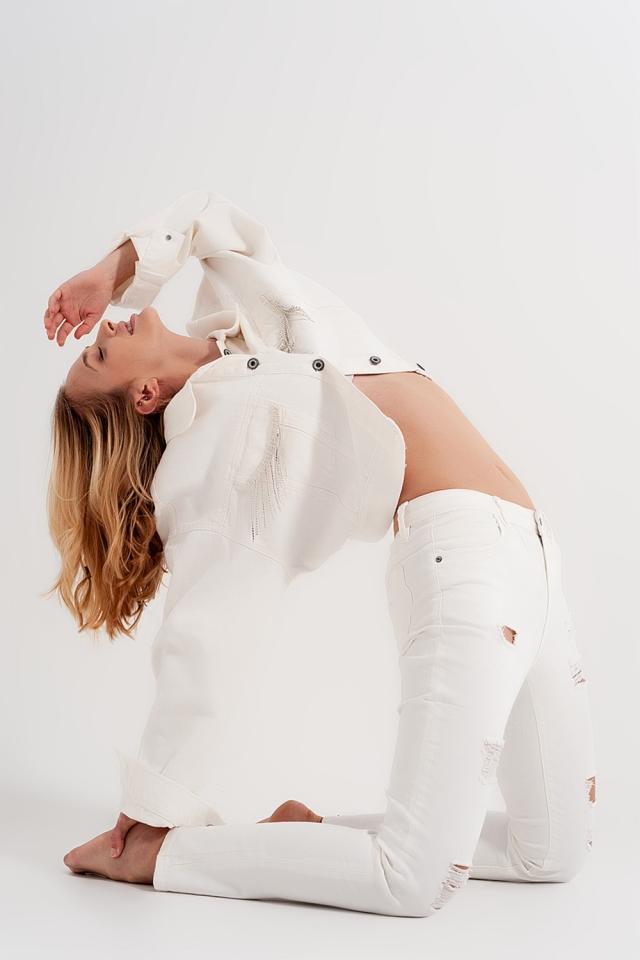 Slim fit jeans met slijtplekken in wit