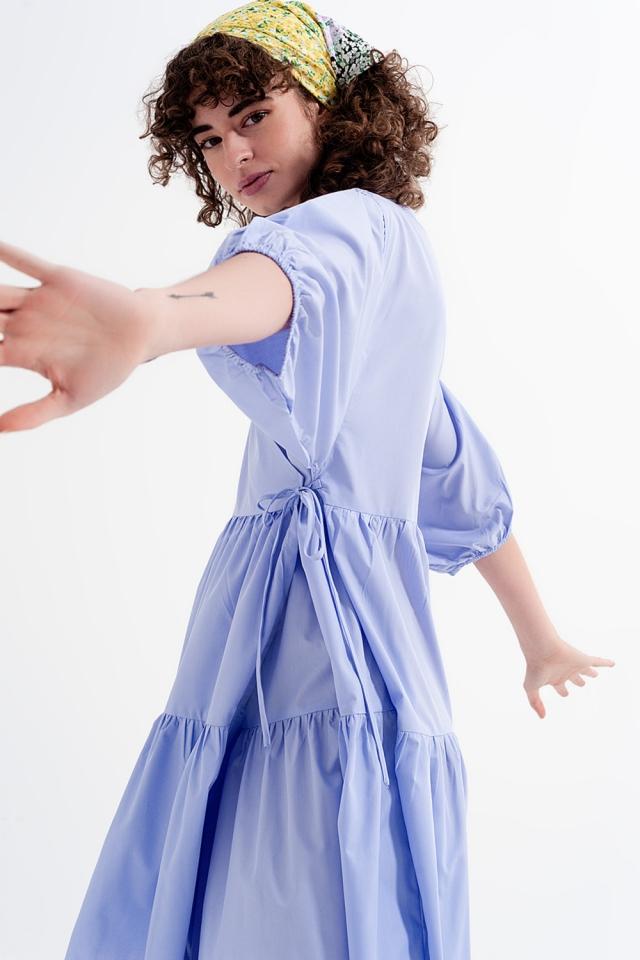 Wijde midi jurk met mouwtjes in het lila