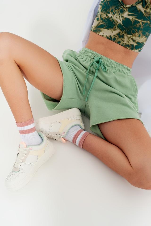 Kortere smalle short van jersey in groen