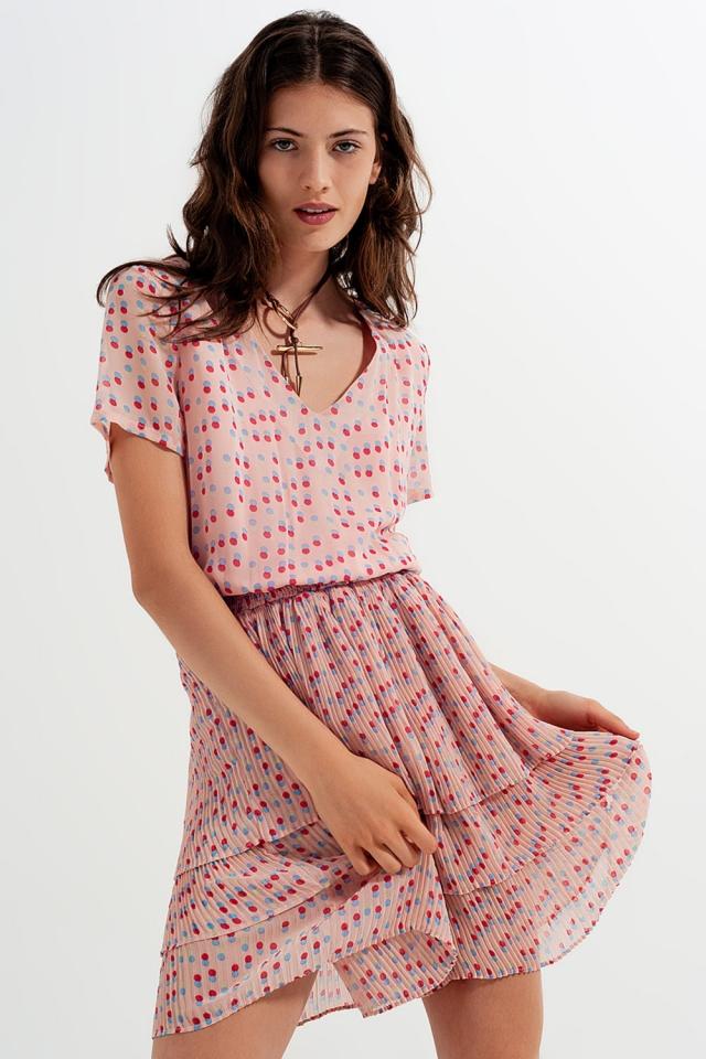 Mini-jurk met smokwerk en strook in roze